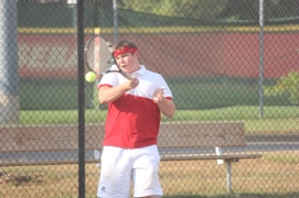 Junior Luke Stock hits a forehand back at #1 singles, filling in for the injured Bradley Cross