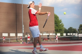 Sophomore Blake Winchell returns a shot against Floyd Central's #2 Singles player