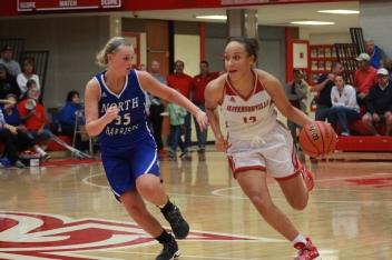 Jacinta Gibson, 11 running past a North Harrison defender.