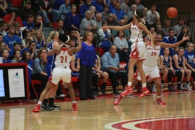 Jeffersonville trying to grab the loose ball.