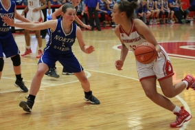 Jacinta Gibson, 11 driving past North Harrison's Taylor Rennirt.