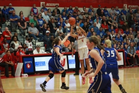 Tori Handley, 10 attempts a jump shot.