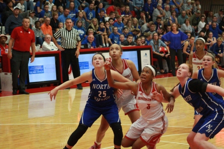 JayLynn Brown, 11 fighting for the rebound against North Harrison defenders.