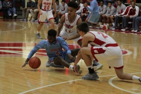 Jacob Jones and Bailey Falkenstein fighting for the loose ball.