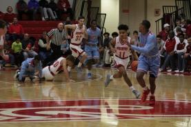 Jacob Jones, 9, with the ball heading down court.