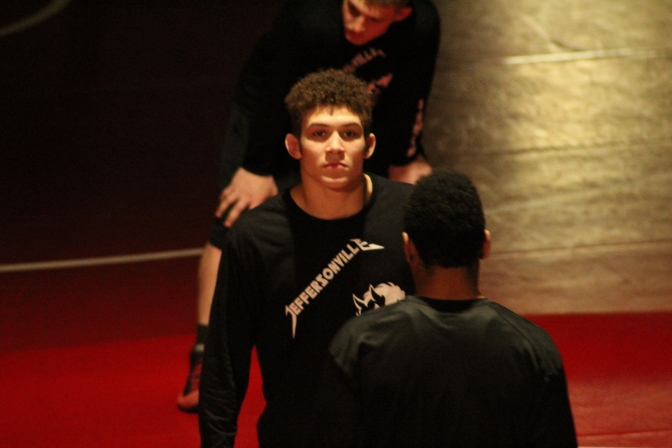 Jeff's Kameron Fuller stares down New Albany's Aaron Mosley before they face off in the sectional final in the 170lb weight class.