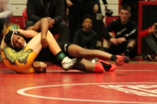 Jeff's Camren Beasley fights to pick up a win in the 113 weight class against Floyd Central's Mex Meyer.