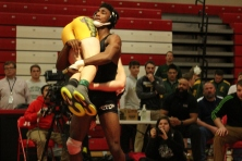 Jeff's Josh Cooper cradles Floyd Central's Joshua Foster in the sectional final in the 152lb weight class.