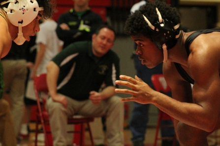 Jeff's Josiah Freeman comes face to face with Floyd Central's Devon Stikes in the sectional final for the 160lb weight class.