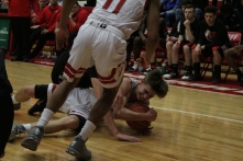 Joe LaGrange dives on the floor for the loose ball.