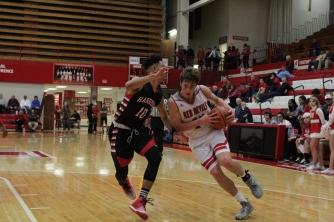 Bailey Falkenstein fights through contact.