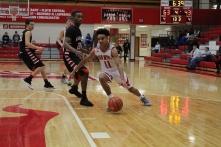 Jacob Jones puts the ball on the floor.