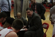Coach Luce draws up the play in a timeout.