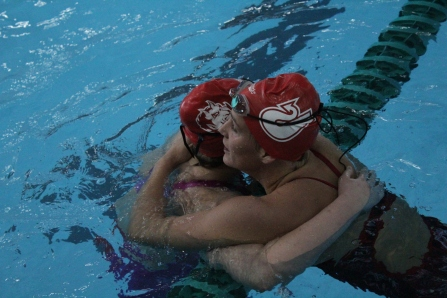 Rachel Walker and Hallie Dixon hugging each other after finishing 1st and 2nd in the event