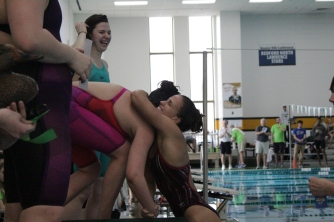Rachel Walker hugs teammate Hallie Dixon during the ribbon ceremony of the 200 yard freestyle.