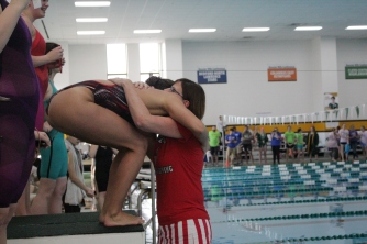 Rachel Walker hugs her mom after she hands her the 1st place ribbon in the 200 yard freestyle.