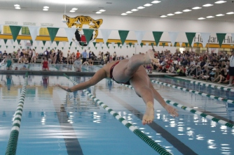 Rachel Walker dives in the water for the 500 yard freestyle.