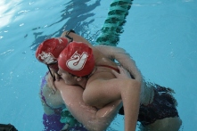 Rachel Walker and Hallie Dixon embracing after placing 1st and 2nd in the 500 yard freestyle.