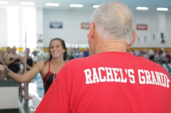 Rachel Walker about to receive 1st place ribbon from her grandfather after winning the 500 yard freestyle.