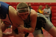 Junior Jacob Laughlin tries to gain leverage against his opponent.