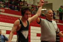 Senior Noah Morrison manages to pick up a win despite breaking his thumb, qualifying him for semi-state.