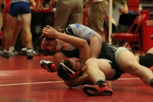 Junior Luke Smith attempts to pin his opponent.