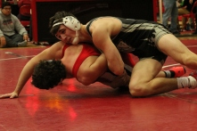 Senior Ashton Smith gains control over his opponent in his last match for Team Jeff.