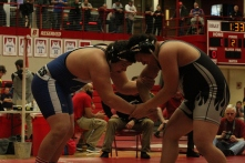 Senior Nathan Long goes head to head with his opponent, qualifying for semi-state earlier in the