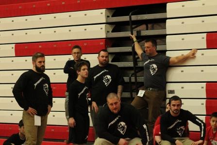 Team Jeff coaching staff and senior Noah Morrison get together to cheer on their senior Ashton Smith.
