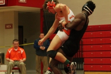 Regional champion Josh Cooper goes for a throw during a winning effort in the regional final for the 152 weight class.