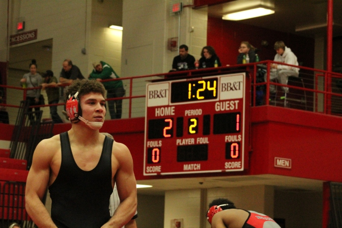 Regional Champion Kameron Fuller in his close win over New Albany's Aaron Mosely in the regional final.