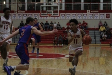 Jacob Jones drives past the defender.