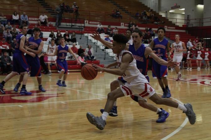 Jacob Jones drives past the defender.