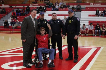 "Gary ""Cowboy"" McCowan pictured with Coach Luce and the Jeffersonville fire department."