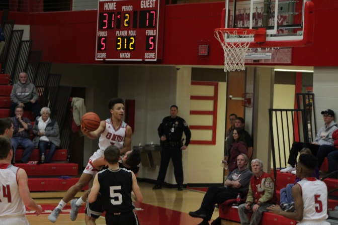 Gabe Gallahar tries to make the layup over the defender.