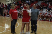 Lyndzy Obremski hugging Tori Guepe during senior night.