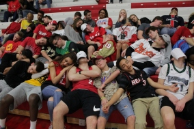 The student section taking a nap during the opposing lineup introductions.