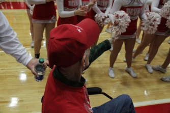 """Gary """"Cowboy"""" McGowan after the game with the cheerleaders."""