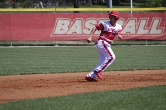 Jack Ellis running back to base.