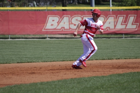Jack Ellis running back to base.