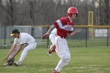 Trey Bottorff running down the first base line.
