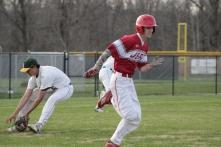Trey Bottorff running down the first base line.