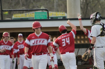 Hunter Schmitz and fellow teammates celebrate a run scored.