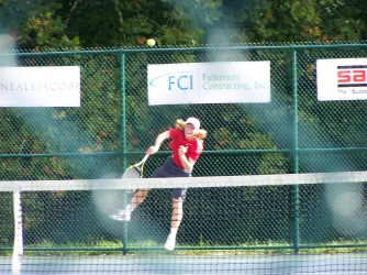 Senior Keith Asplund serves to Foldy one singles