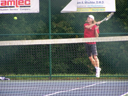 Senior Keith Asplund hits a forehand return to Floyd's one singles Kyle poe