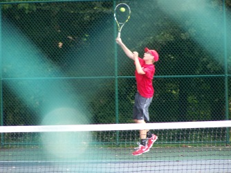 Freshman Charley Williams, JV one singles, serves to Floyd Thursday afternoon