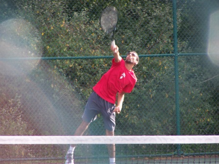 Senior Ney Thaker serves to Floyd JV