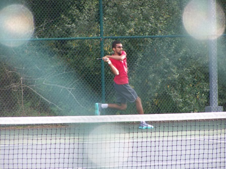 Senior Ney Thaker hits a backhand in the match against Floyd