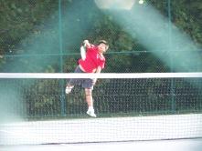 Sophomore Tein-Lu serves in a JV match against Floyd