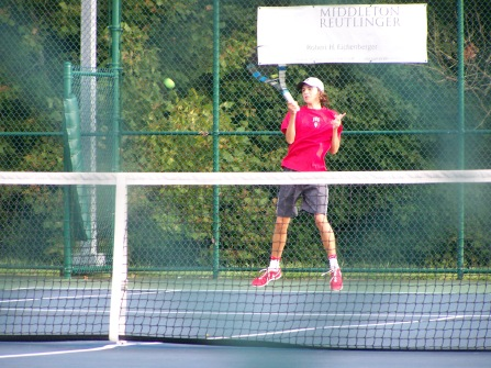Senior Jerid Inman returns floyds serve with a forehand Thrusday afternoon at the Foldy match
